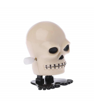 Игрушка череп заводной